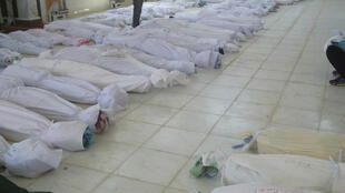 Bodies laid out in a mosque in Houla