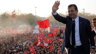 Not so fast: Ekrem Imamoglu of the opposition Republican People's Party, waves to supporters after taking up his job as mayor of Turkey's largest city.