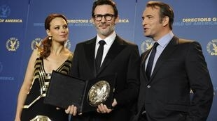 Oscar winner MIchel Hazanavicius (C) wants culture exempted