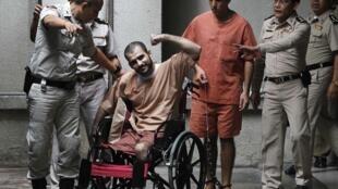 Saeid Moradi (dans le fauteuil) et Mohammad Khazaei ont été condamnés pour un complot contre des diplomates israéliens, le 22 août 2013 à Bangkok .