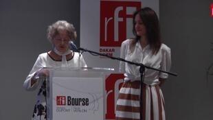 Lors du discours de Marie-Solange Poinsot, mère de Ghislaine Dupont, aux côtés d'Apolline Verlon-Raizon, fille de Claude Verlon, le 2 novembre 2017.