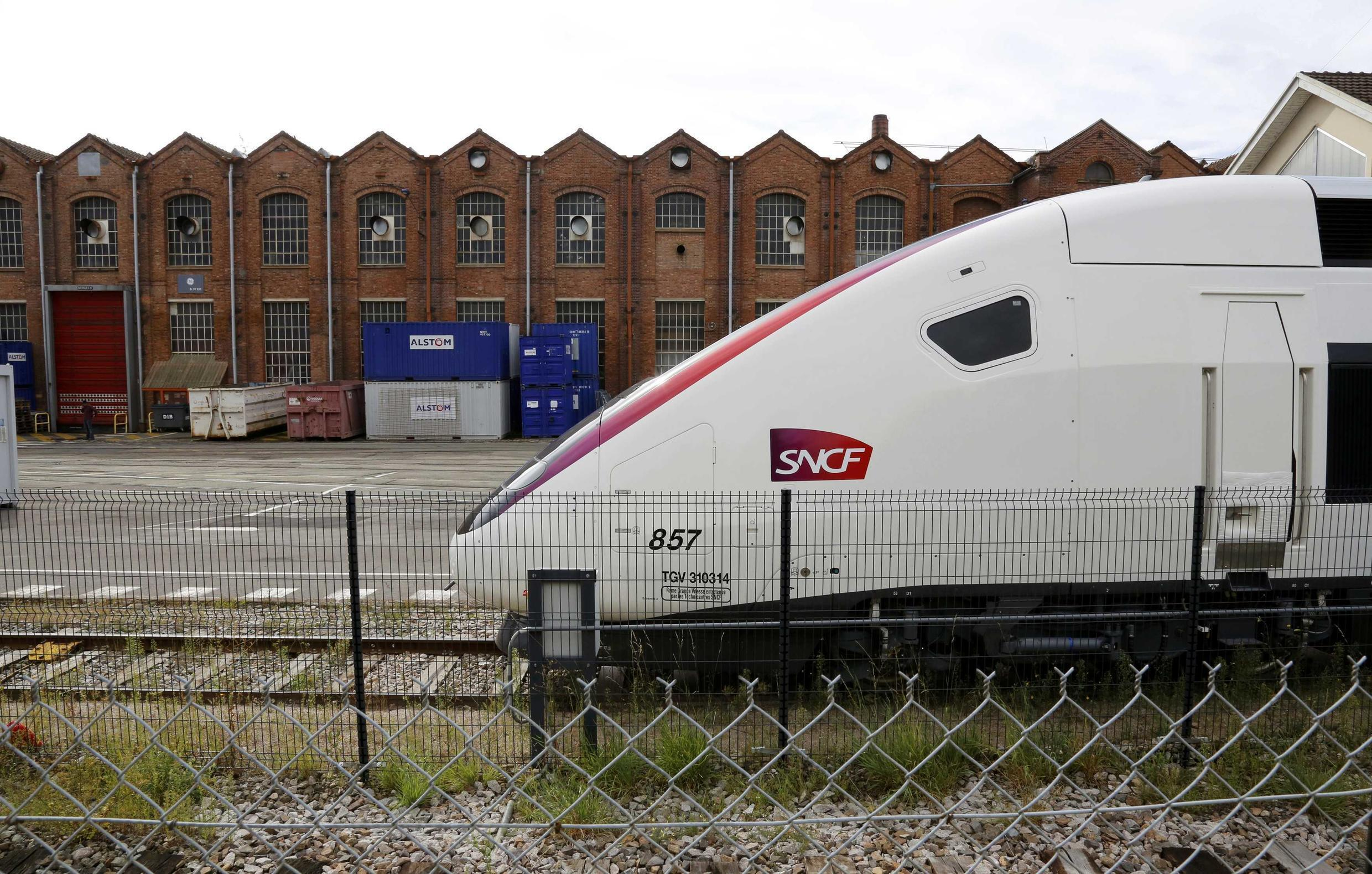 A TGV in front of the main plant of the French engineering giant Alstom in Belfort