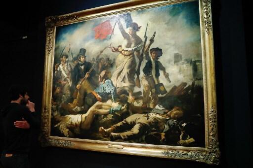 """""""A liberdade a guiar o povo"""", a obra mais famosa do pintor francês Eugène Delacroix."""