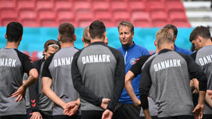 Dream big: Denmark coach Kasper Hjulmand talks to his squad at training on Friday
