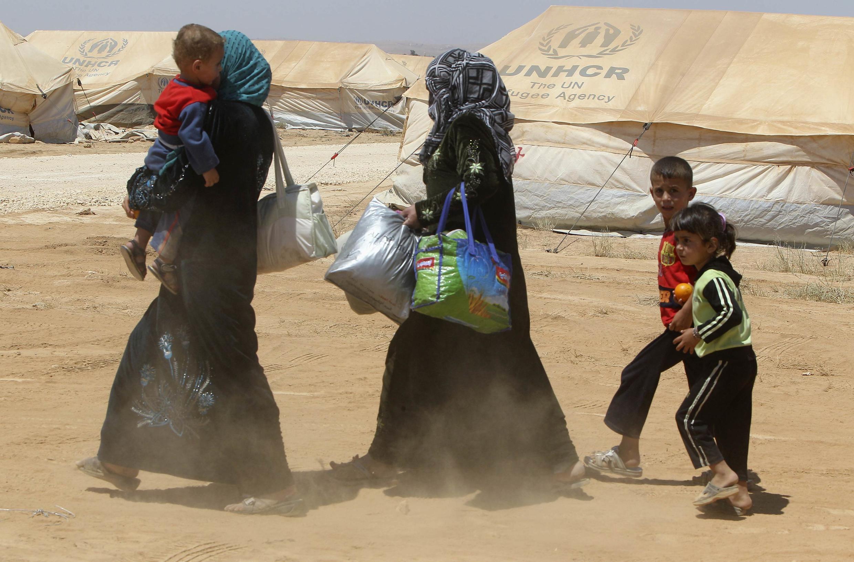 Syrian refugees arrive at the Al Zaatri refugee camp, 8 August, 2012