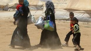 Syrian refugees arrive at the Al Zaatari refugee camp, 8 August, 2012