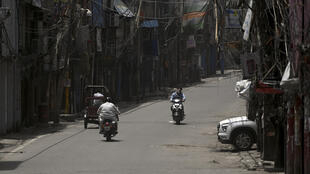 A semi-deserted market during a lockdown imposed in Delhi