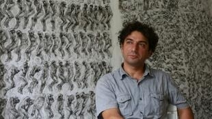 Syrian artist and painter Najah Albukai has exhibited dozens of his drawings across France