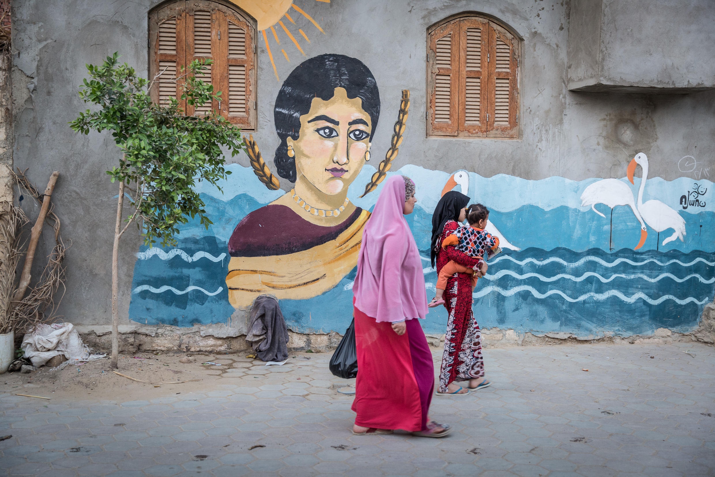 Wall paintings throughout the village of Tunis, Egypt