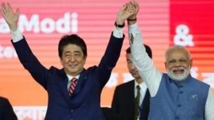 日本首相安倍晋三与印度总理莫迪资料图片