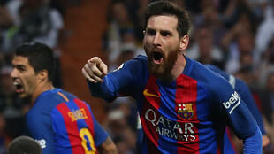 Barcelona's Lionel Messi celebrates scoring their third goal against Real Madrid.
