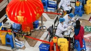 A resident receives the China National Biotec Group (CNBG) Covid-19 vaccine in Shenyang, in China's northeastern Liaoning province
