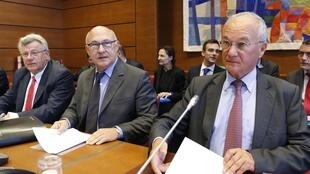 (R) President of the Financial Commission Gilles Carrez, (C) French Finance Minister Michel Sapin (C) and (L) Budget Minister Christian Eckert attend a parliamentary financial commission hearing in Paris, October 1, 2014.