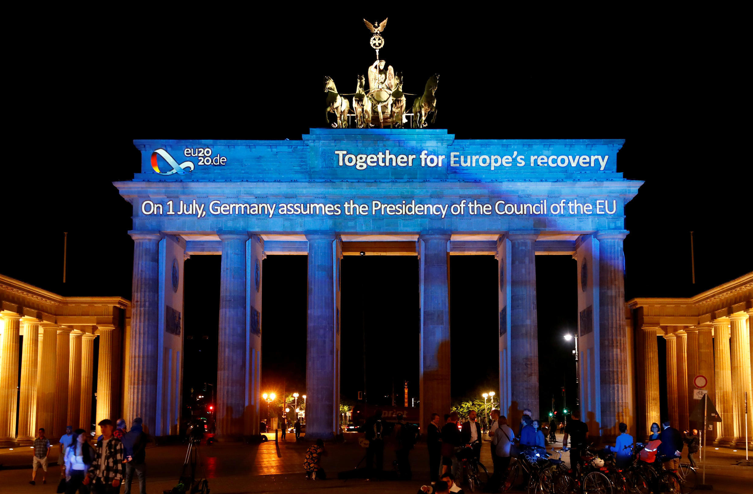 Germany marks the beginning of a six-month presidency of the European Union dedicated to coronavirus recovery with projections on the Brandenburg Gate in Berlin, 30 June 2020.