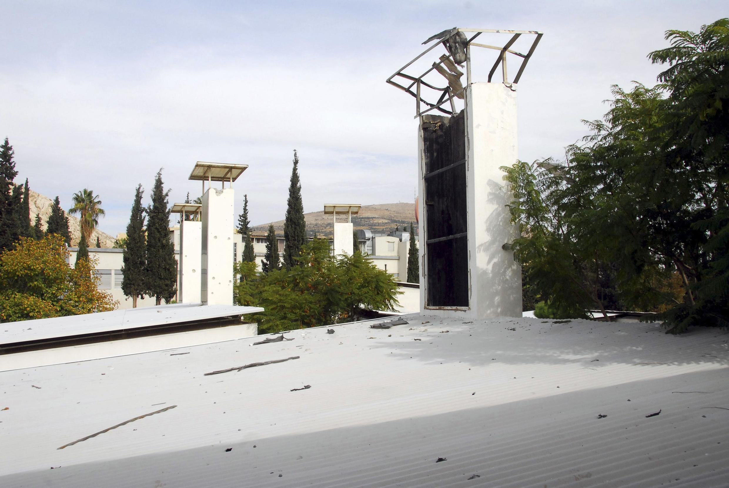 Damage after a mortar shell landed on the French school in Damascus, Syria