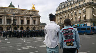 Police officers stand guard on the Opera square, near the Olympia, in Paris after the concert of Congolese artist Heritier Watanabe was cancelled on July 15, 2017 due to clashes near the concert hall by protesters.