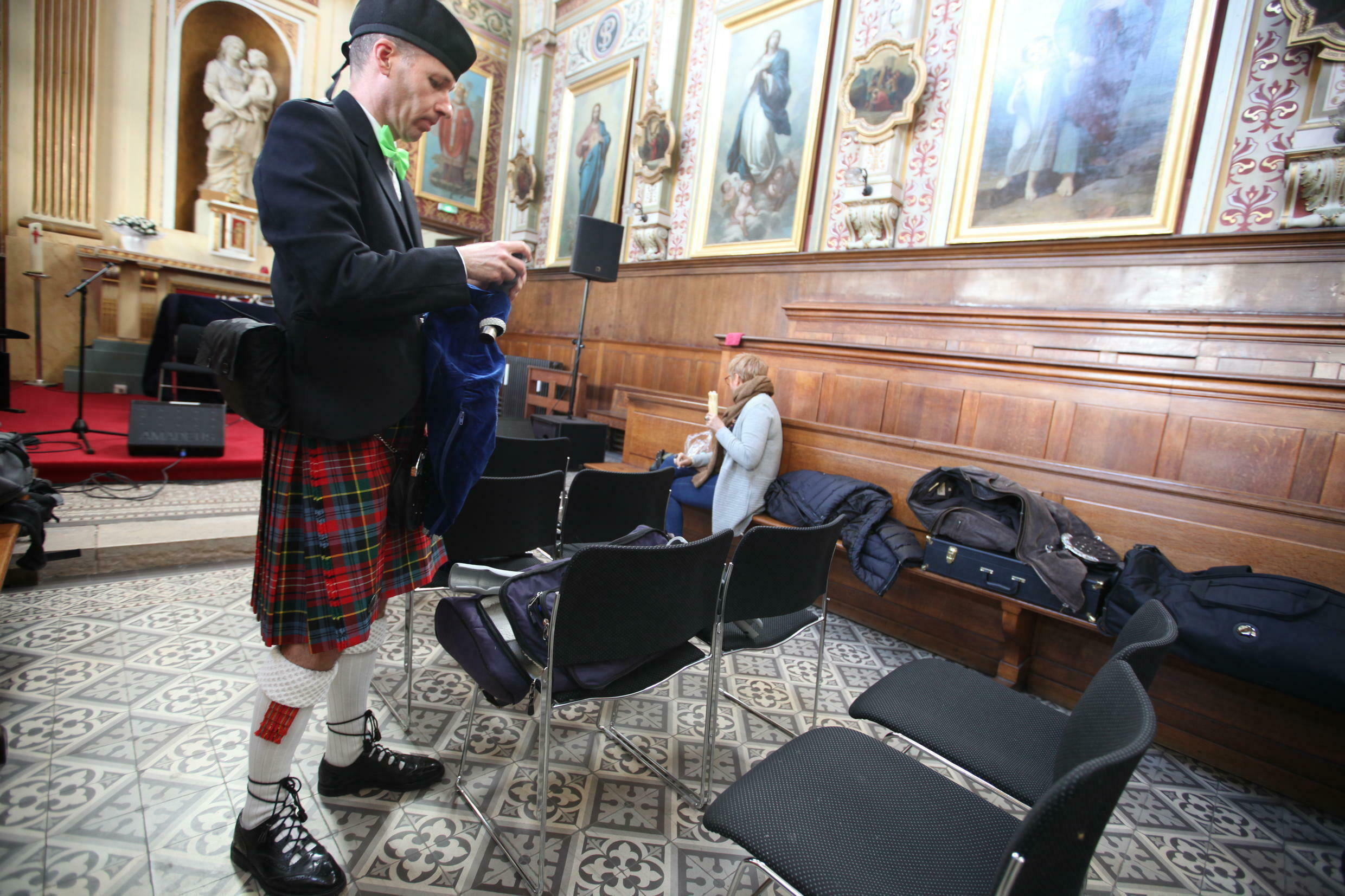 Bagpipers prepare for Saint Patrick's Day in the chapel of the Irish Cultural Centre.