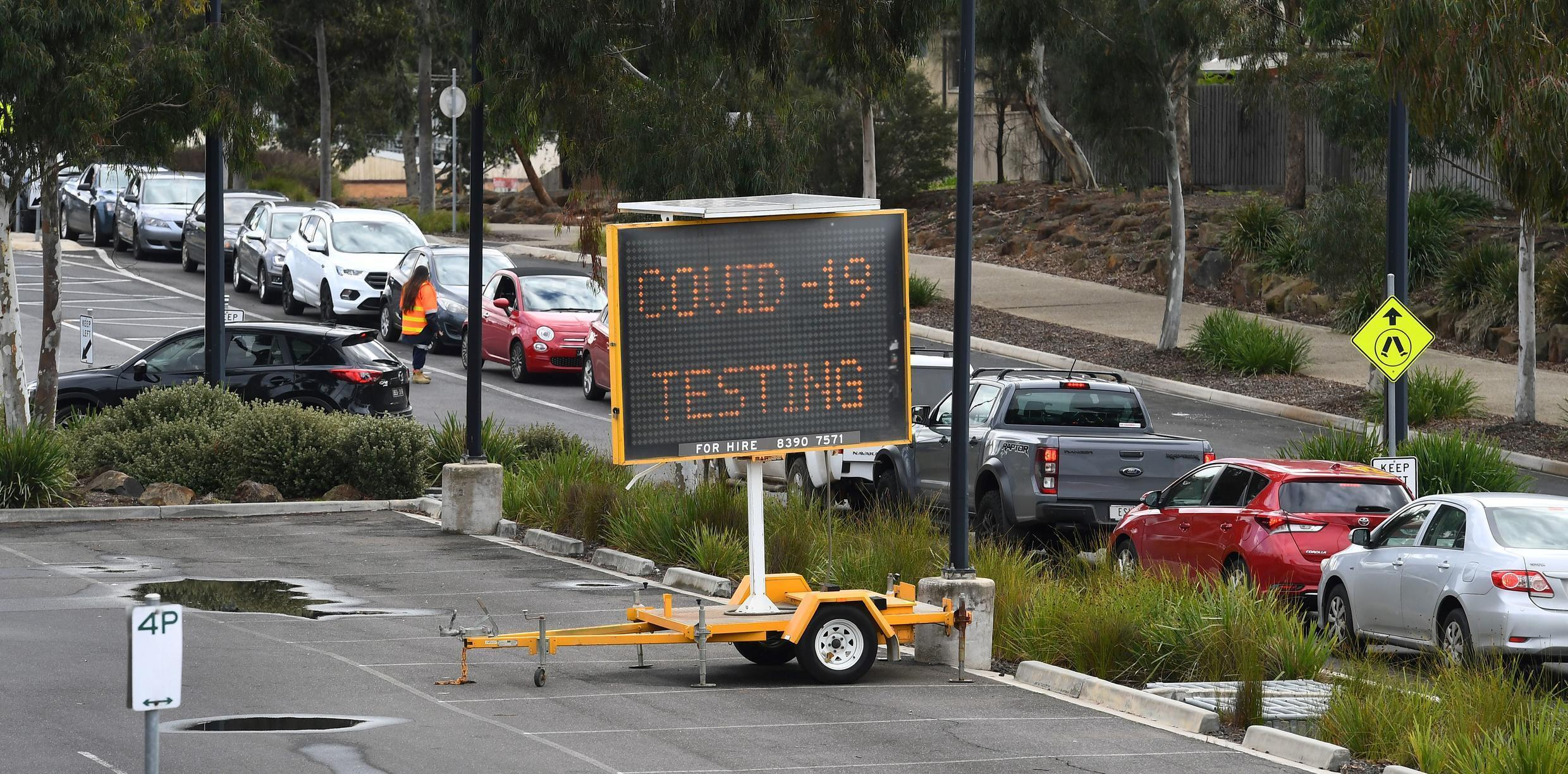 A long queue of cars wait at a drive-through COVID-19 testing site in Melbourne