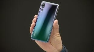 Telecom equipment company Huawei's new P20 smartphone in Paris on March 27, 2018.