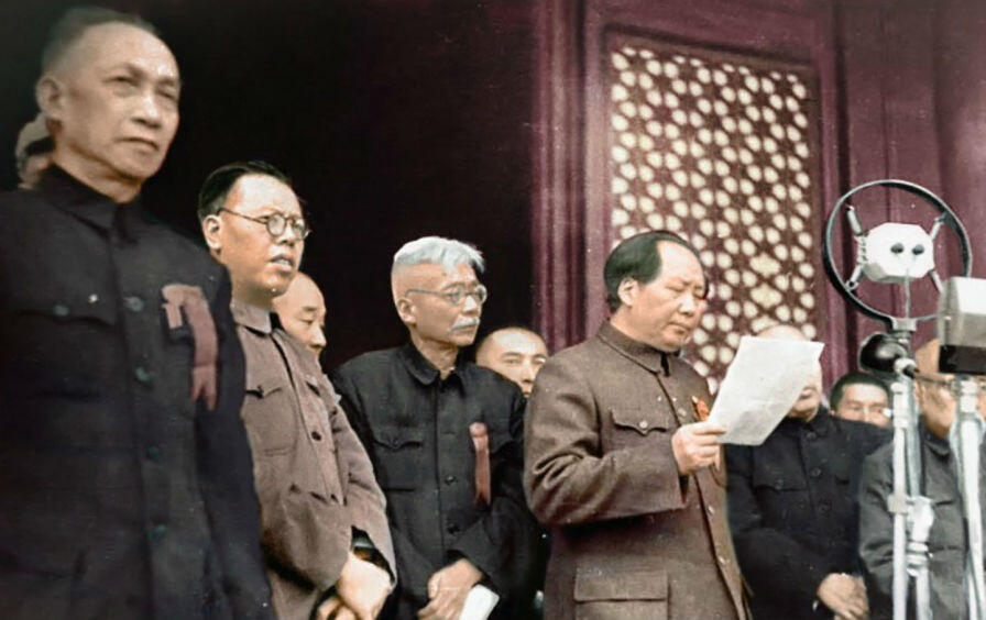 Mao Zedong, standing on the roster of the Tiananmen Gate overlooking the square, proclaiming the establishment of the People's Republic of China, on 1 October, 1949.