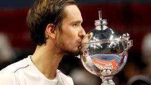 Daniil Medvedev kisses the trophy after winning the Japan Open.