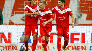 Jean Zimmer (centre) celebrates with Takashi Usami (left) and Mathhias Zimmermann after scoring a spectacular second goal for Fortuna Dusseldorf against Bundesliga leaders Borussia Dortmund.