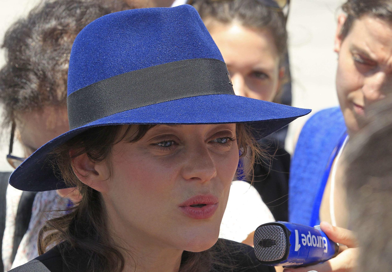 A atriz francesa Marion Cotillard leu o discurso do presidente François Hollande , em Manila nas Filipinas.