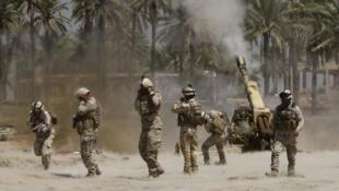 Sur le terrain, les affrontements continuent entre l'EIIL et l'armée irakienne, comme ici à Jurf al-Sakhar, au sud de Bagdad, lundi 30 juin.