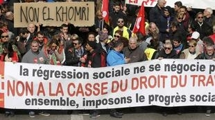 "French labour union workers attend a demonstration against the French labour law proposal in Marseille, France, as part of a nationwide labor reform prostest, March 9, 2016. The slogan reads ""No to the break-up of right to work legislation""."