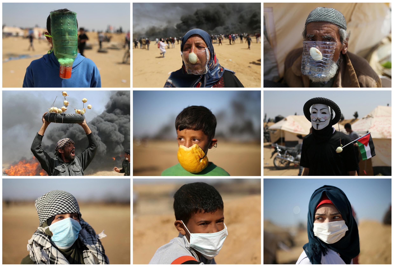 Un ensemble avec plusieurs manifestants palestiniens avec des masques de fabrication artisanale, notamment, pendant un rassemblement à la frontière entre Gaza et Israël, le 6 avril 2018.