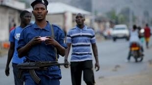 Burundi police patrol the streets of the Musaga district in the capital Bujumbura after the results of the elections, 24 July 2015.