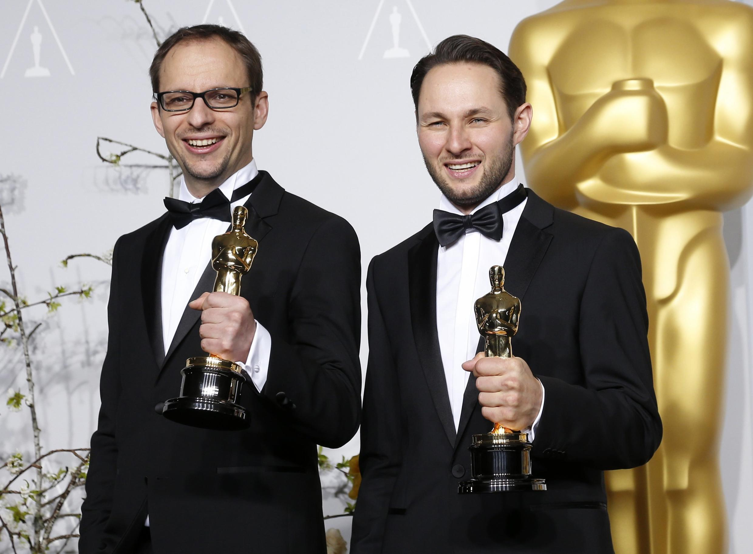 """Laurent Witz and Alexandre Espigares with their award for best animated short film """"Mr. Hublot""""."""