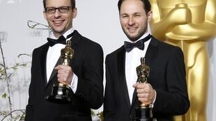 "Laurent Witz and Alexandre Espigares with their award for best animated short film ""Mr. Hublot""."
