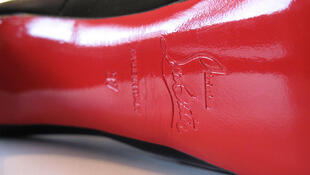 The red sole by French shoemaker Christian Louboutin