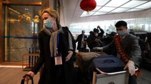 Đoàng chuyên gia của Tổ chức Y tế thế giới kết thúc chuyến điều tra nguồn gốc đại dịch Covid-19, ngày 10/02/2021, sân bay Vũ Hán, Trung Quốc.