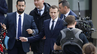 French President Emmanuel Macron (R) with former aide Alexandre Benalla (L).