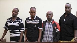 Somali pirates stand at the dock during their sentencing at a court in the Kenyan coastal town of Mombasa