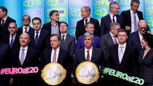 European Central Bank President Mario Draghi and eurozone finance and economy ministers celebrate the 20th anniversary of the euro at a meeting in Brussels, Belgium, December 3, 2018.