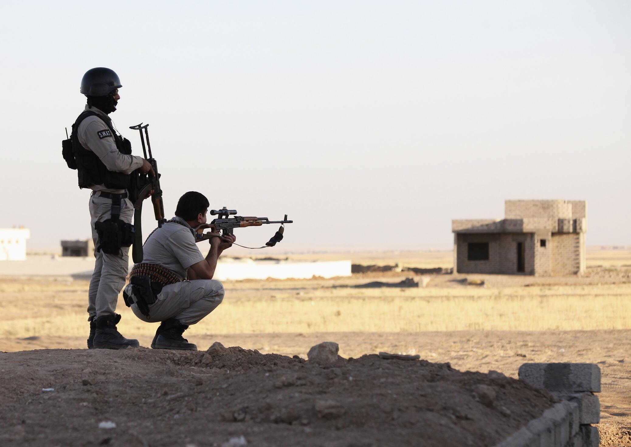 Курдские подразделения пешмерга участвуют в боевых дейтсвиях против джихадистов, 9 августа 2014 г.