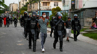 Cuban forces have arrested dozens following unprecedented anti-government protests
