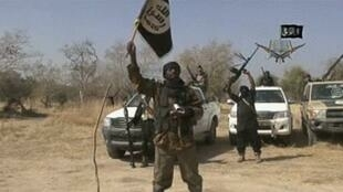 Boko Haram Leader Abubakar Shekau in front of his fighters