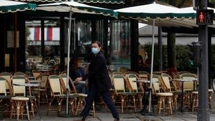 Some Parisian cafés have been allowed to remain open under strict new health conditions after the government placed the French capital and its near suburbs on the country's highest Covid-19 alert level.