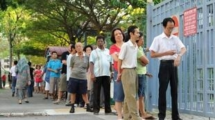 Voters queue in Singapore