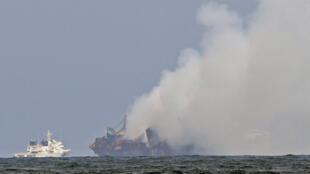 Smoke billows from the MV X-Press Pearl off the coast of Sri Lanka on Monday