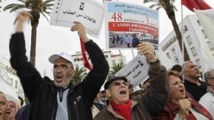 Miembros de la AMDH reclaman la protección de los Derechos Humanos en el país, en Rabat, el pasado 16 de noviembre de 2014.