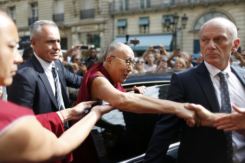 The Dalai Lama leaving his hotel in Paris on 13 September, 2016.