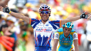 Katusha's Joaquin Rodriguez Oliver of Spain celebrates as he crosses the finish line to win