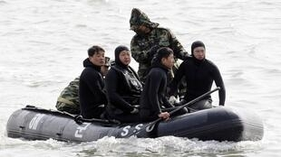 A rescue team from the South Korean navy on patrol to rescue survivors