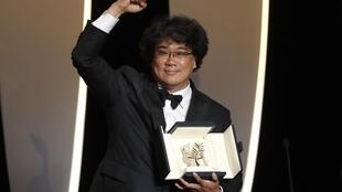South Korean film director Bong Joon-Ho, a triumphant Golden Palm winner in Cannes, for 'Parasite' 25 May 2019.
