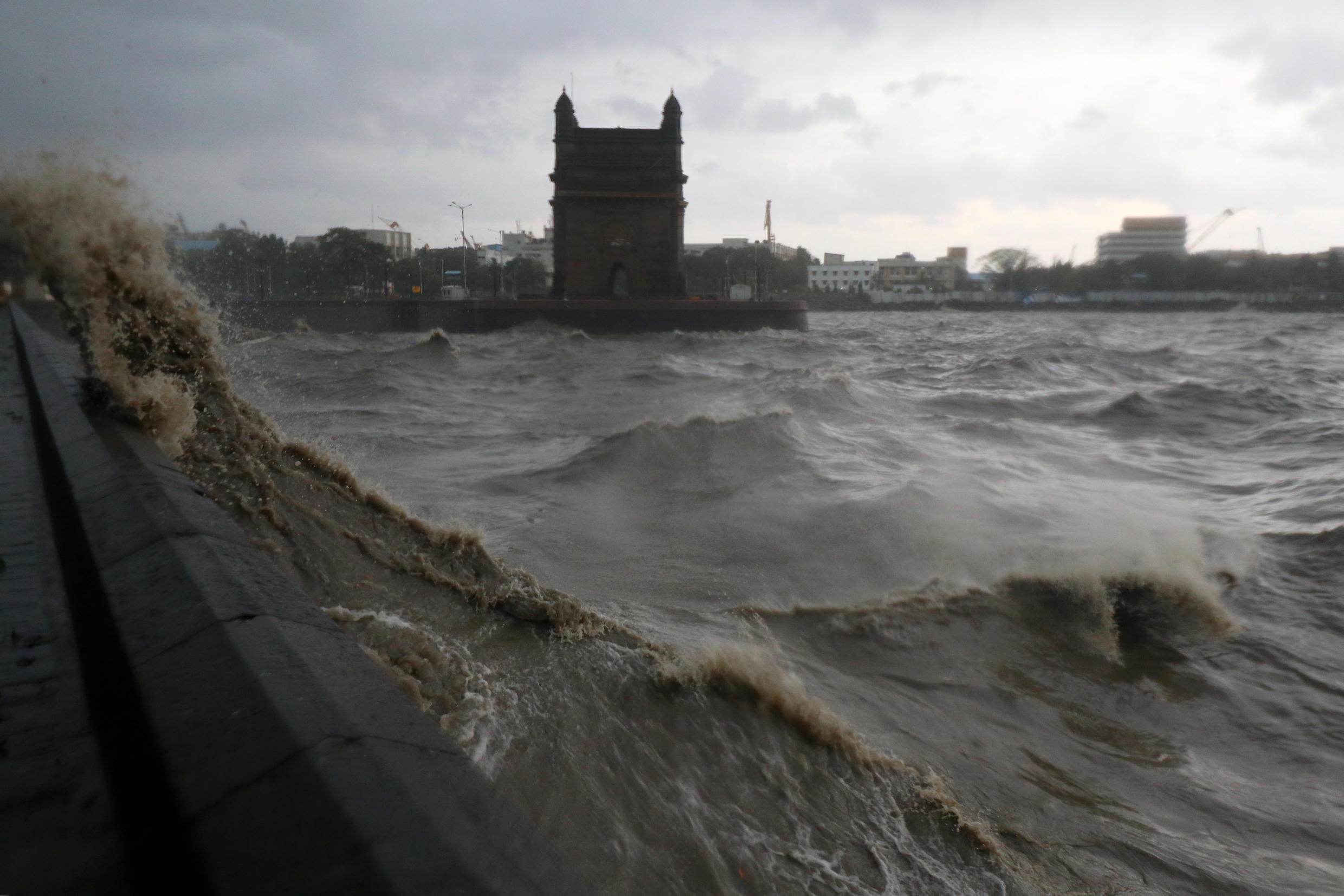 Waves caused by Cyclone Tauktae crash up on the promenade near the Gateway of India monument in Mumbai, India, May 17, 2021.
